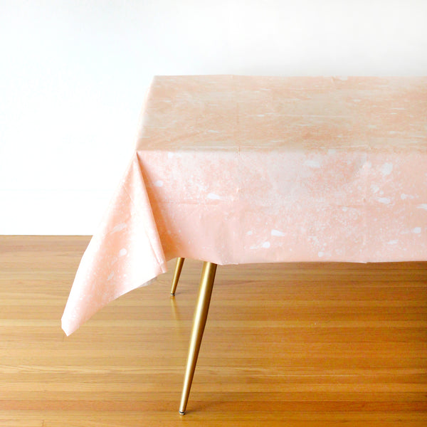 blush party table cover setup on gold table