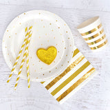gold and white polka dot plates with a shiny gold heart cookie