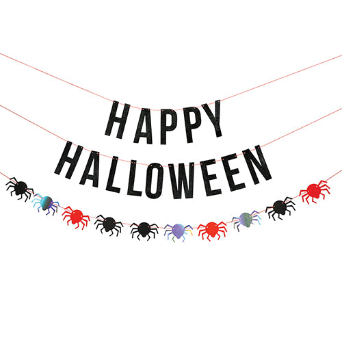 Halloween Party Banner hanging on the wall with spiders