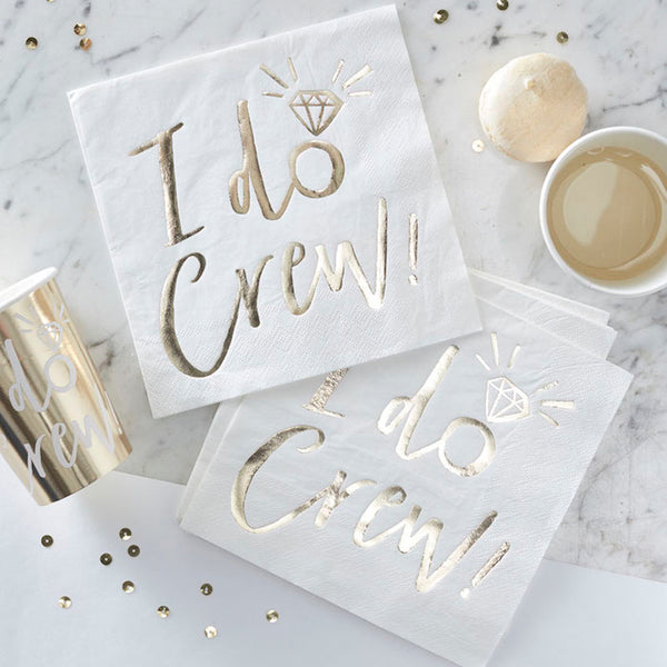 "white paper napkins with ""I Do Crew!"" in gold foil"