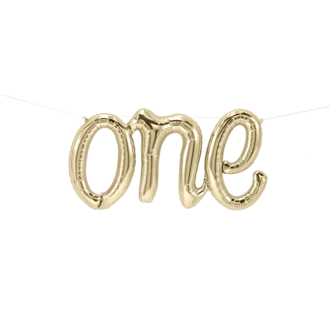 Gold One Balloon Banner Hanging From White Wall