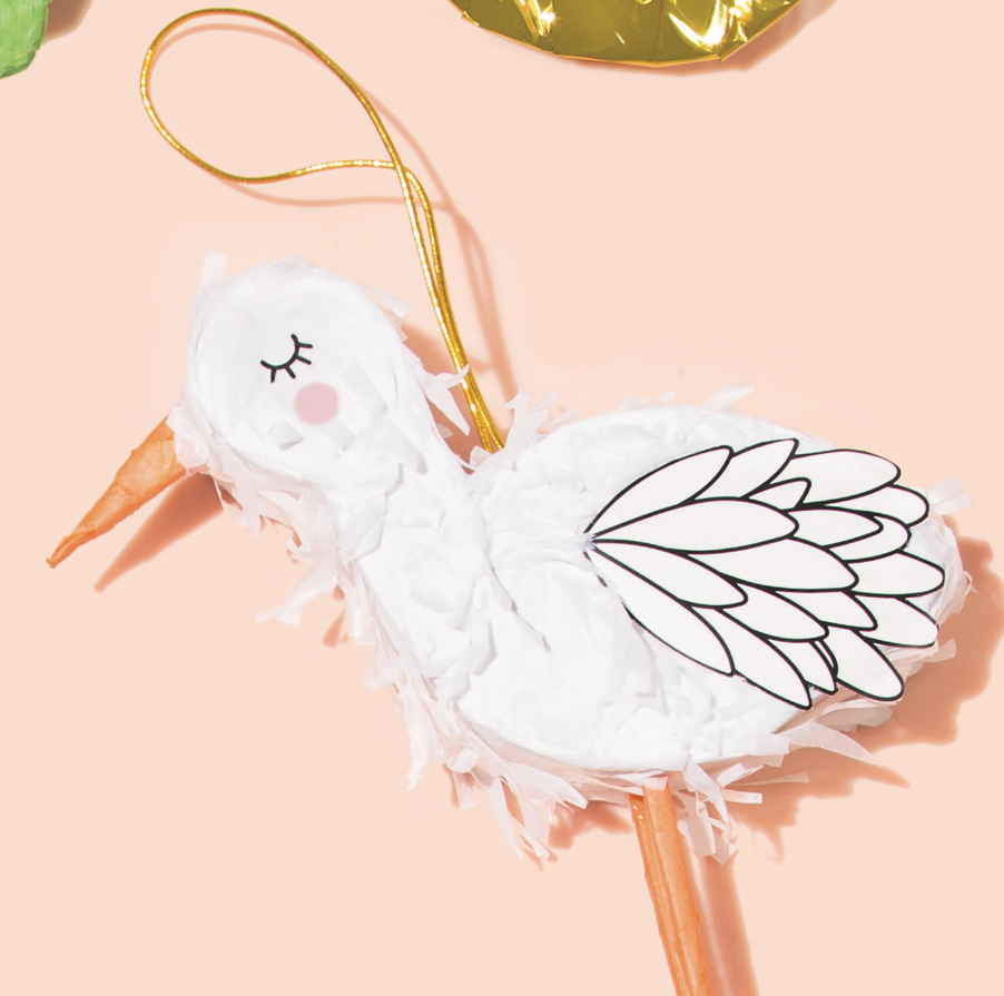 Tiny Stork Piñata against peach background