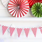 red banner shaped as a triangle with white stripes hanging from mantel