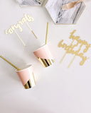 blush pink and gold foil cups on white table