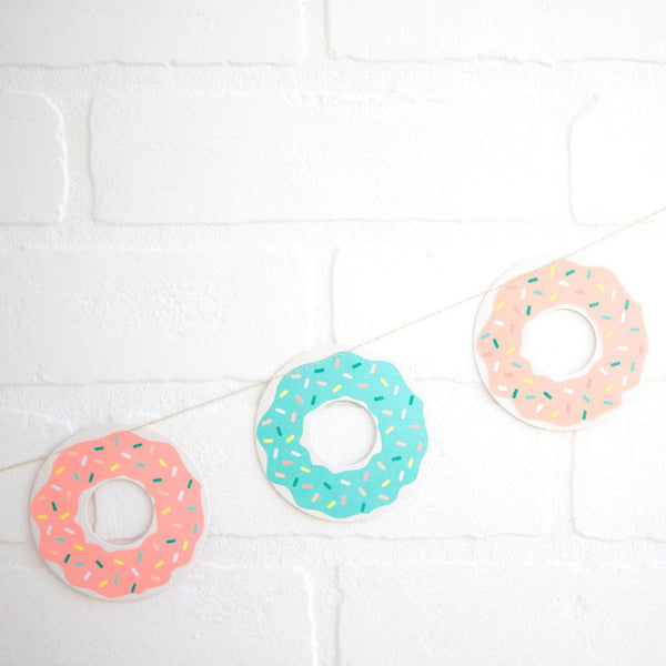 colorful donut garland hanging on a white wall