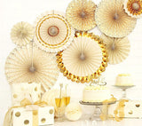 shimmering gold party decor on wall at cake table
