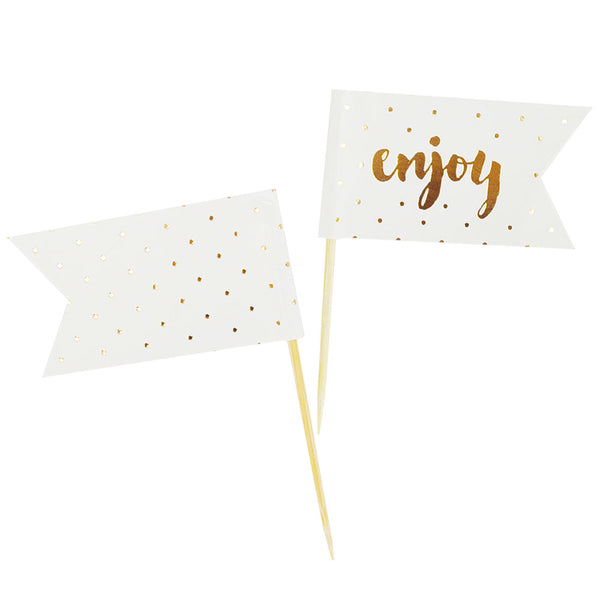 white and gold food party picks that say enjoy