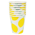 a stack of white and yellow lemon party cups