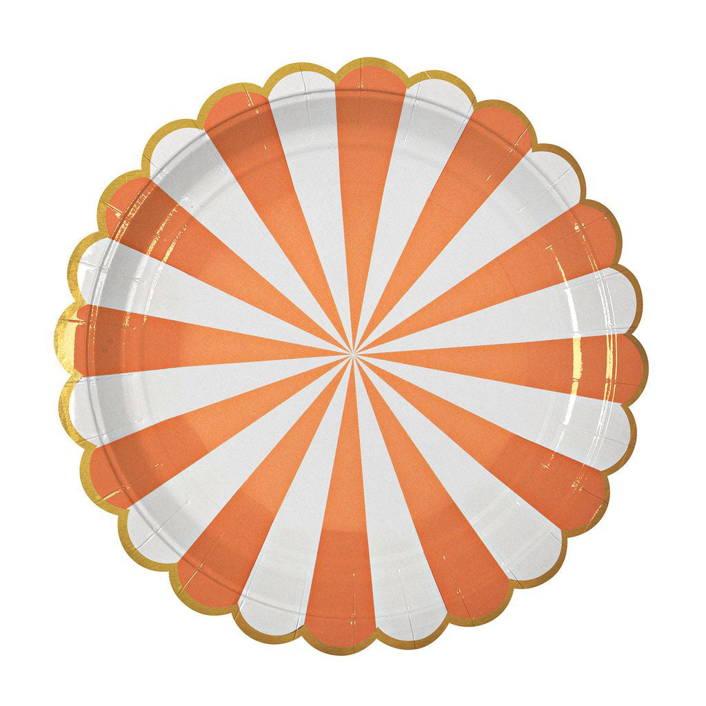 Orange plates designed with white stripes and a gold scalloped edge.