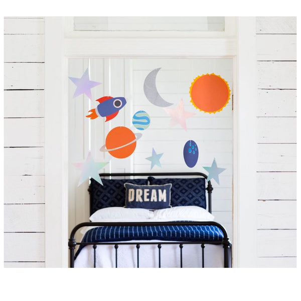 Outer Space Decor hanging over a boys bed