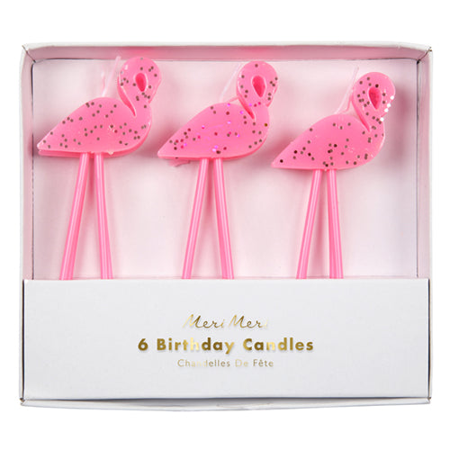 a pack of bright pink flamingo cake candles with silver sparkles