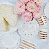 rose gold polka dot plates with cake