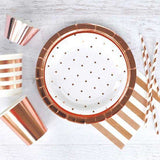 rose gold party supplies on table