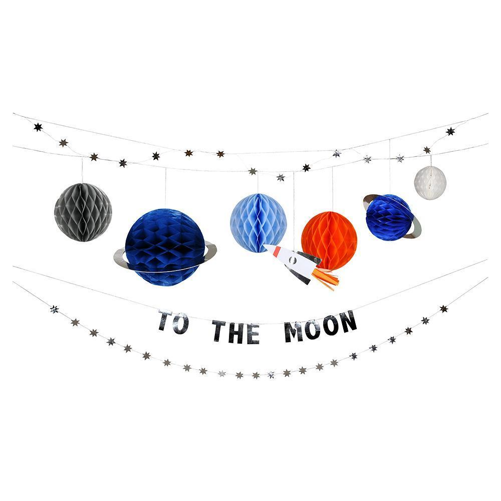 to the moon party garland with paper planets and stars