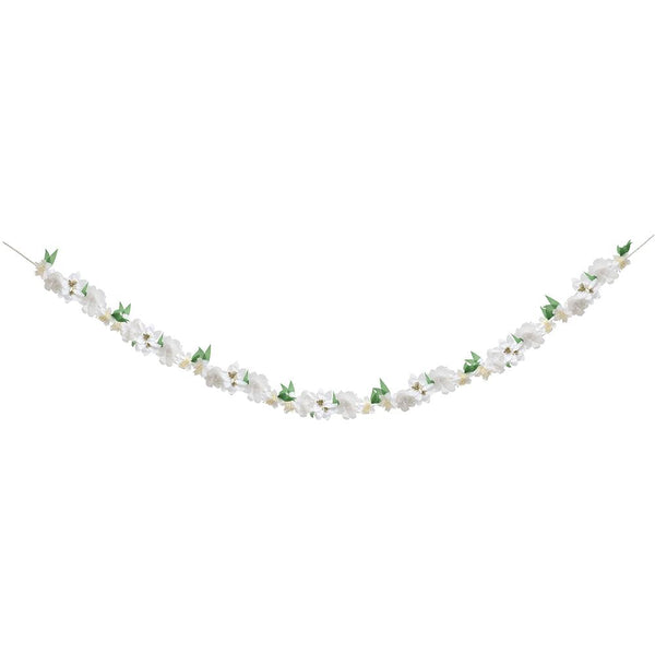 white blossom garland strung onto string