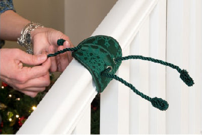 Attach the Banister Saving Garland Tie to the banister