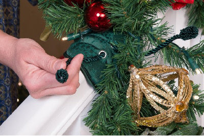 Secure the garland to the Banister Saving Garland Tie