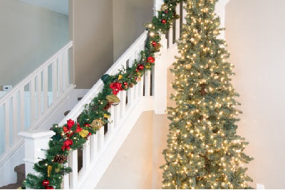Beautiful Garland on Banister Railing, Next to Christmas Tree