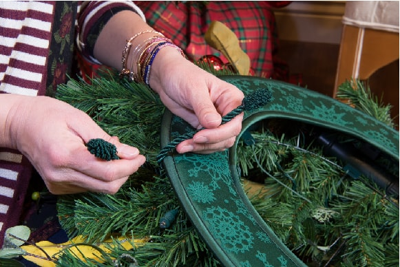 Installing the Door Protecting Wreath Pad onto a Wreath