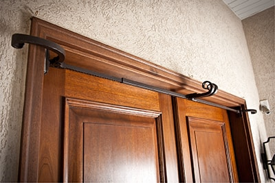 Village Lighting Double Door Garland Hanger in Doorway
