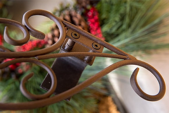 Close up of padded hook bracket on the Village Lighting Antler Wreath Hanger