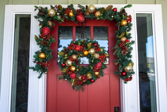 Scarlet Hydrangea Wreath and Garland Hanging On Front Door