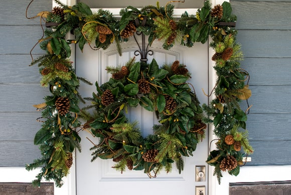 Magnolia Leaf Wreath and Garland Hanging On Front Door