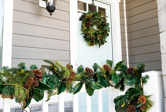Magnolia Leaf Wreath and Garland Hanging on front pourch