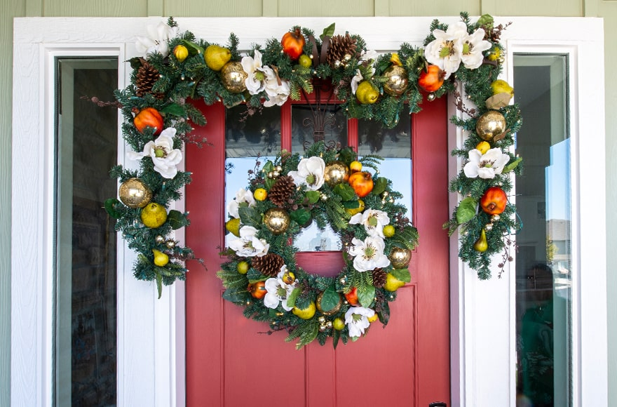 Magnolia Orchard Wreath and Garland Hanging On Front Door