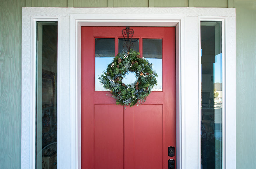 Rustic White Berry Wreath Hanging On Front Door