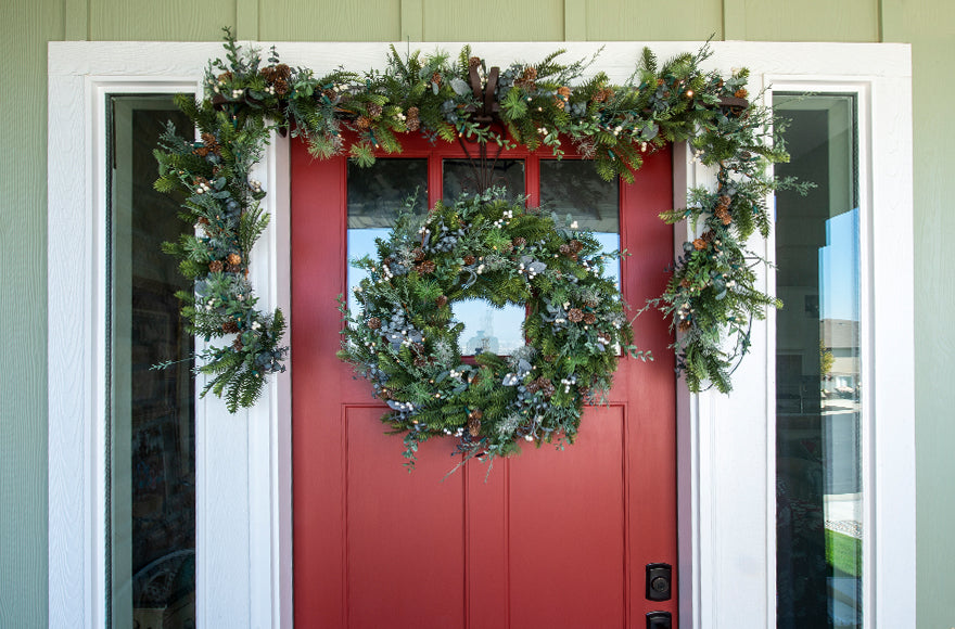 Rustic White Berry Wreath and Garland Hanging On Front Door