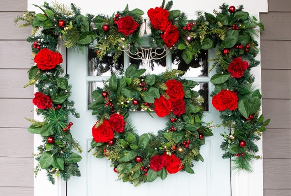Red Peony & Berry Wreath and Garland Hanging On Front Door