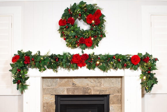 Red Peony & Berry Wreath and Garland Hanging Above Fireplace Mantle