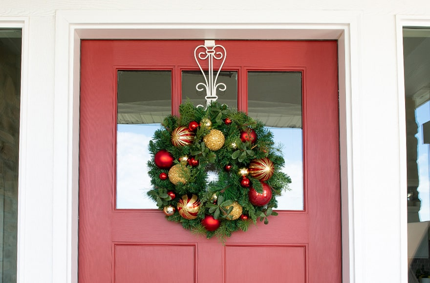 Christmas Classic Red and Gold Wreath Hanging On Front Door