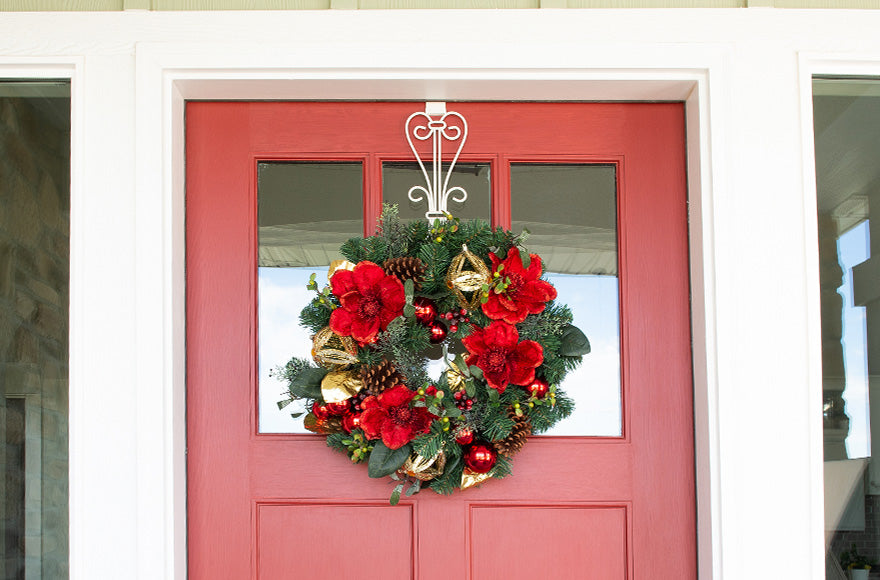 Red Magnolia Wreath Hanging On Front Door