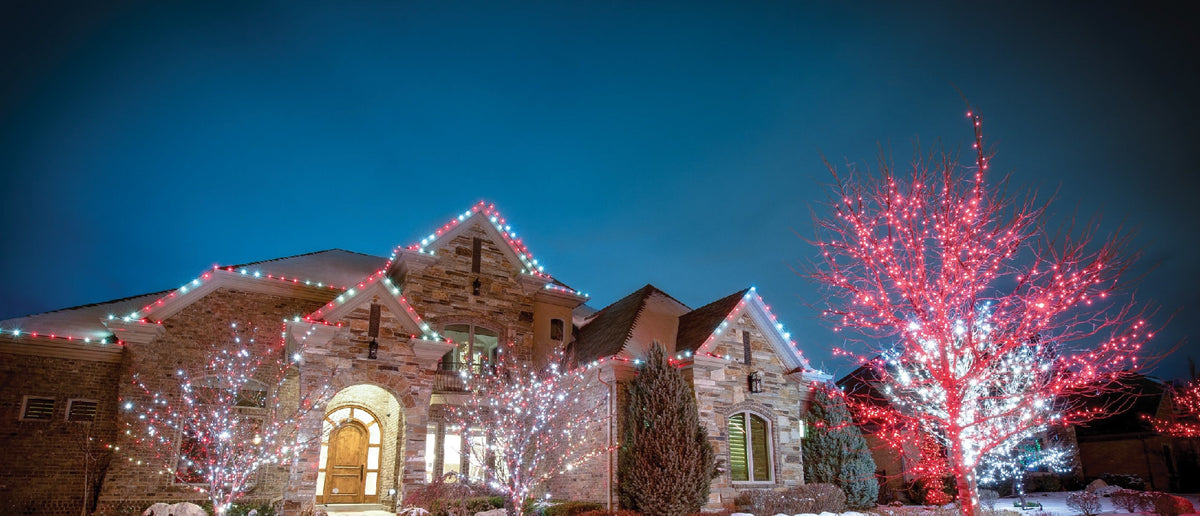 Village Lighting Company Red and Winter White C7 Christmas Lights on a House Roofline