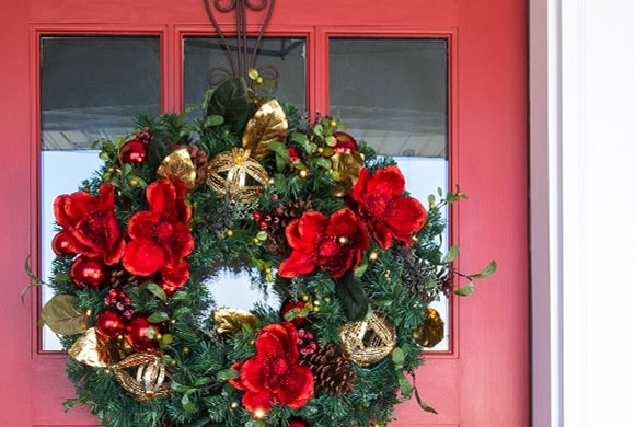 Village Lighting Wreath on Red Door with Nun Chuck™ Battery Pack installed