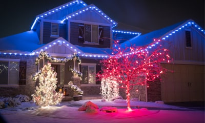 Light Stream bulbs on house with blue, red, and white light themes