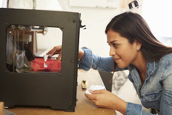 Female Architect Using 3D Printer