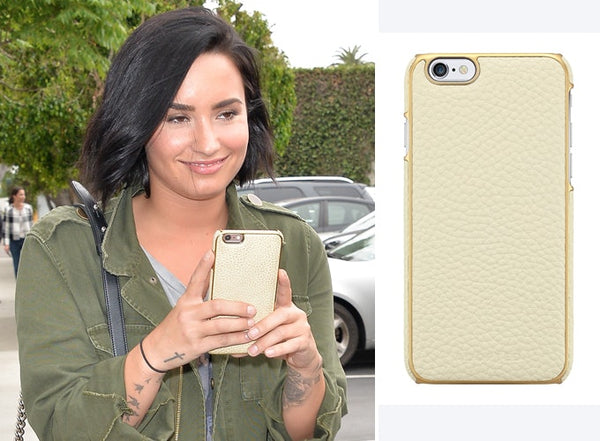 Demi Lovato cream and gold phone case