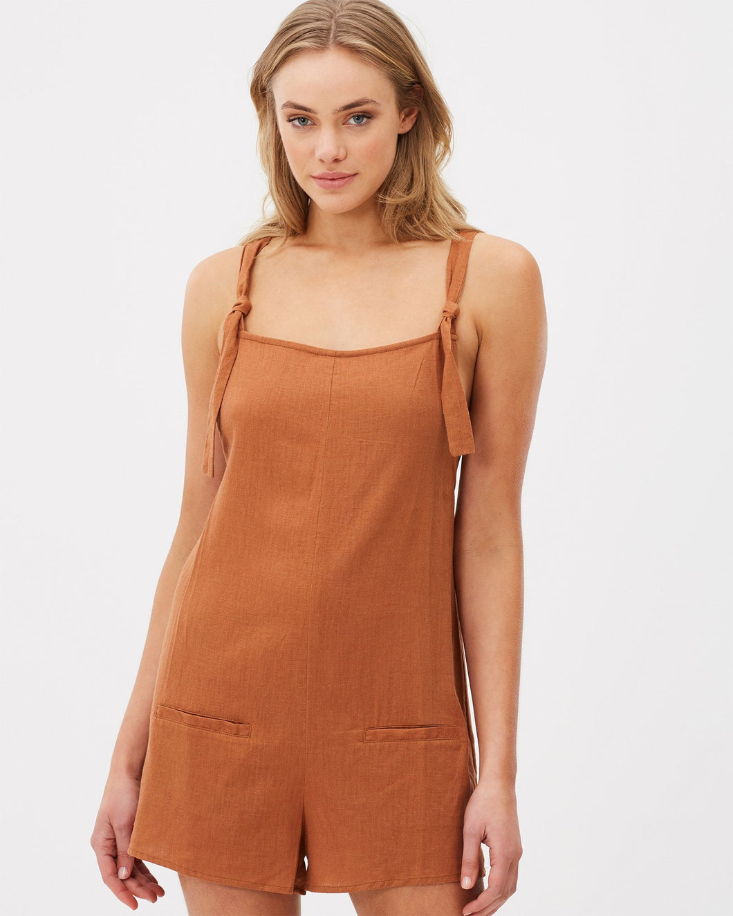 Linen romper in terracotta by Charlie Holiday
