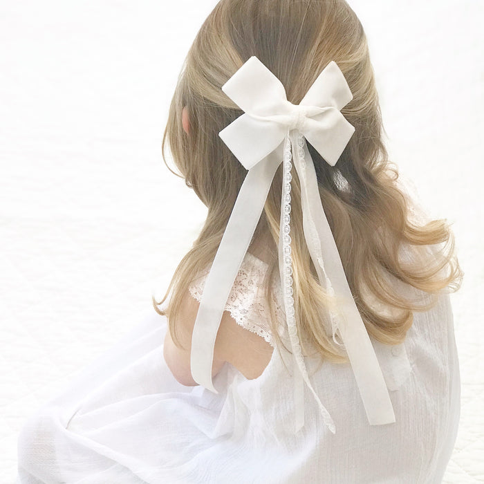 Little Love velvet bow hair clip in ivory, flower girl bow hair clip, large velvet bow uk, ivory velvet hair bow, bow for flower girl, ivory flower girl bow, flower girl hair accessories uk, flower girl accessory, oversize velvet bow with ties, flower girl hairbows, ivory velvet hairbows for flower girls, large white velvet bow