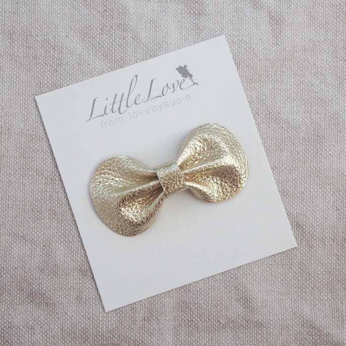 Coco leather bow hair clip in neutral shades, muted pastels and soft metallics, Girls Hair Clips, Hair Bow, Gold Hair clip, Metallic Leather Bows, Gold Bow Hair clip, Toddler Hair Bow in gold, Gold Leather Hair Bow, Little Love Leather Bow, Gold Hair bow, Metallic Leather Bow Hair Clips, Little Girls Hair Bows in gold