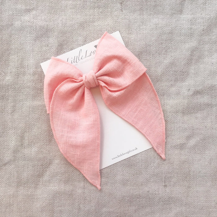Shop Little Love pink linen bow hair clips for girls, plain linen bow hair clips, pink linen hair bow, pink linen hair bow, pink linen hair bow, pink linen hair clip bow, little love handmade hair bows, oversize bow hair clips, girls hair bows, pink hair bows for girls in linen, children's hair accessories UK, hair accessory UK