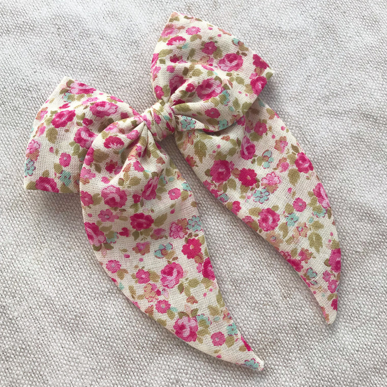 Little Love posy pink floral print cotton bow hair clips for little girls, floral print cotton bow hair clips, pink flower print cotton floral hair bow, pink print bow fabric hair clips, little love handmade hair bows, oversize pink bow hair clips, handmade hair bows uk, pink ditsy floral hair bow, pink liberty floral bow