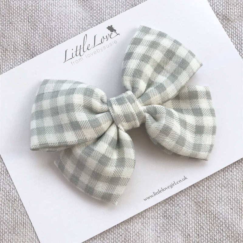 Shop Little Love gingham cotton bow hair clips in grey for little girls, grey gingham cotton bow hair clip, grey hair bow, checked bow hair clips, gingham hair bows, grey cotton hairbow, cotton baby bow headband, gingham, gingham toddler bow hairclip, grey check bow, gingham hairbow, cotton bows, handmade hair bows uk