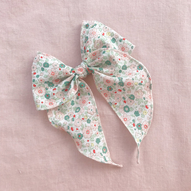 Little Love Eden mint green and pink floral print cotton bow hair clips for little girls, floral print cotton bow hair clips, pink flower print cotton floral hair bow, liberty  print bow fabric hair clips, little love handmade hair bows, oversize libertyfabric bow hair clips, girls hair bows, liberty cotton hair bows UK, green liberty floral bow
