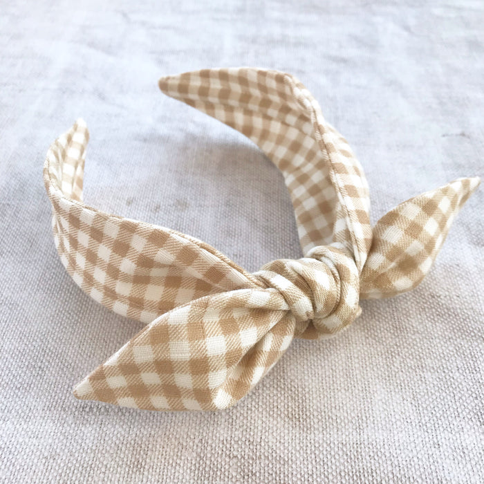 childrens tied knot bow headbands in grey and biscuit gingham cotton, on trend tied bow headband, grey knot headband for girls, gingham bow hairband, childrens hair accessory, grey cotton bow hairband, little girls hair accessories, gingham hairbow, cotton hairbow, gingham bow alice band, girls knot bow headbands
