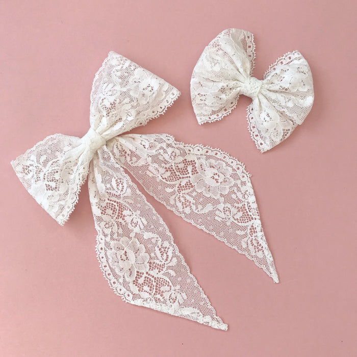 Little Love lace bow hair clip in ivory, flower girl bow hair clip, large lace bow uk, ivory lace hair bow, lace bow for flower girl, ivory flower girl bow, flower girl hair accessories uk, uk flower girl accessory, flower girl hair accessories, flower girl hair bows, flower girl lace bow, vintage lace bow barrette