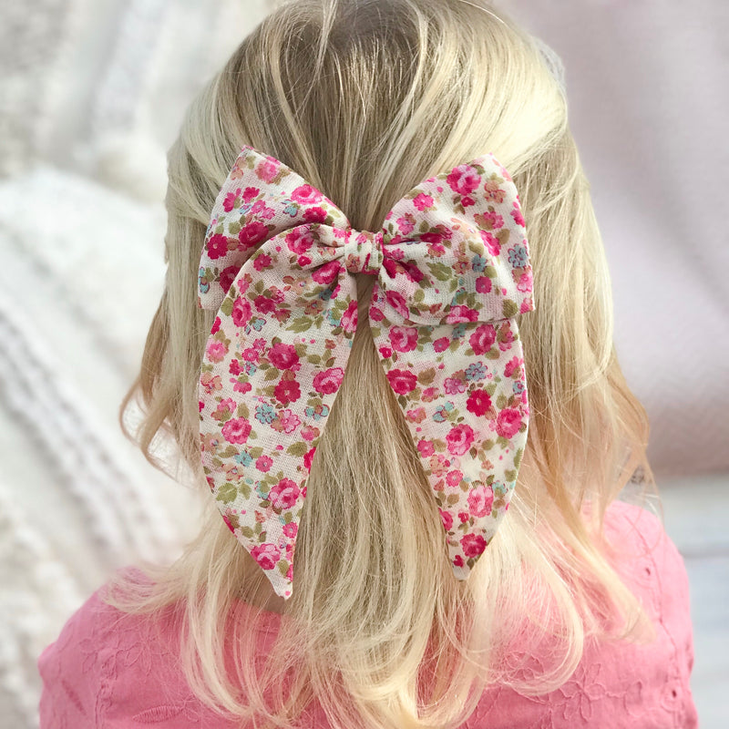 Little Love posy pink floral print cotton bow hair clips for little girls, floral print cotton bow hair clips, pink flower print cotton floral hair bow, pink print bow fabric hair clips, little love handmade hair bows, oversize pink bow hair clips, girls hair bows, pink cotton hair bows, pink liberty floral bow